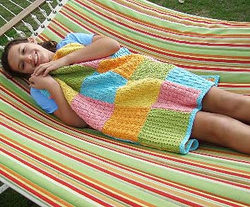 Finished Measurements: 29 inches by 32 ½ inches  Yarn: Spud & Chloë Sweater (55% superwash wool, 45% organic cotton; 100 grams/160 yards), 2 skeins each in Pollen #7508, Grass #7502, Splash #7510, Firefly #7505 and Watermelon #7512  Needles: US size 7 needles or the size needed to obtain the gauge (I used a 24-inch circular to work back and forth for the squares and edging.)  Gauge: 5 stitches per inch