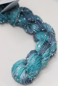 artyarns beaded silk with sequins light  in color 610