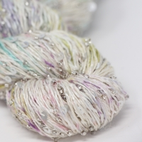artyarns beaded silk with sequins light  in color 611