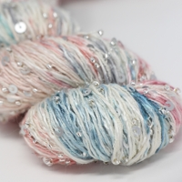 artyarns beaded silk with sequins light  in color 613
